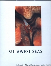 SULAWESI SEAS by Mike Severns. A Superbly photographed  160 page large format hardback book with slightly damaged dust cover. Hundreds of large photographic plates